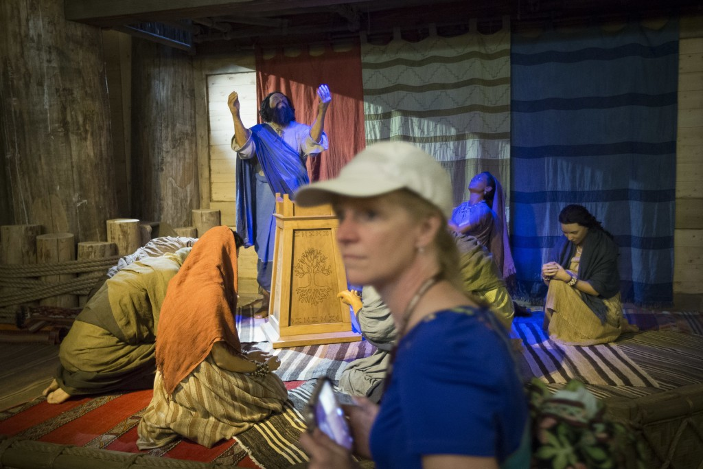 A visitor passes a diorama of Noah and his family praying inside a replica Ark at the Ark Encounter theme park during a media preview day, Tuesday, July 5, 2016, in Williamstown, Ky. The long-awaited theme park based on the story of a man who got a warning from God about a worldwide flood will debut in central Kentucky this Thursday. The Christian group behind the 510 foot-long wooden ark says it will demonstrate that the stories of the Bible are true. Its construction has rankled opponents who say the attraction will be detrimental to science education. (AP Photo/John Minchillo)