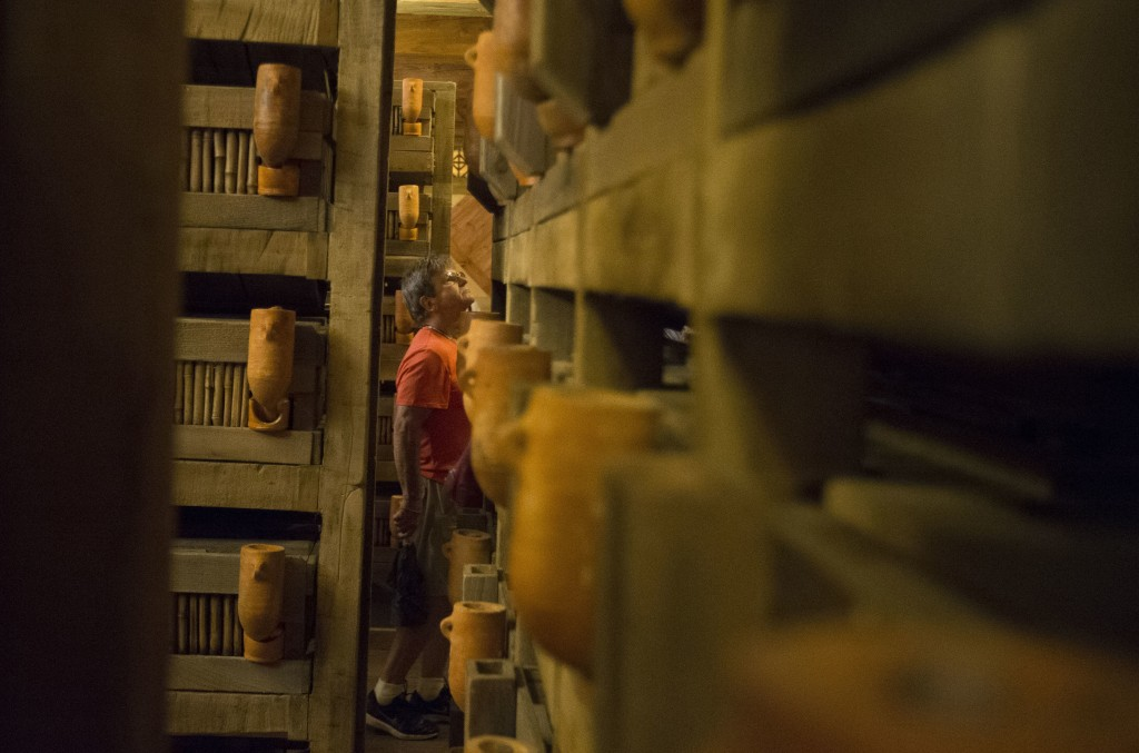 A visitor browses animal crates inside a replica of Noah's Ark at the Ark Encounter theme park during a media preview day, Tuesday, July 5, 2016, in Williamstown, Ky. The long-awaited theme park based on the story of a man who got a warning from God about a worldwide flood will debut in central Kentucky this Thursday. The Christian group behind the 510 foot-long wooden ark says it will demonstrate that the stories of the Bible are true. Its construction has rankled opponents who say the attraction will be detrimental to science education. (AP Photo/John Minchillo)