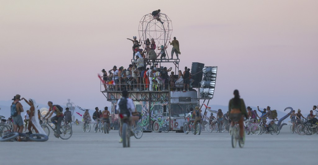 In this Wednesday, Aug. 31, 2016 photo, an art car moves along the playa during Burning Man at the Black Rock Desert north of Reno, Nev. (Chase Stevens/Las Vegas Review-Journal via AP)