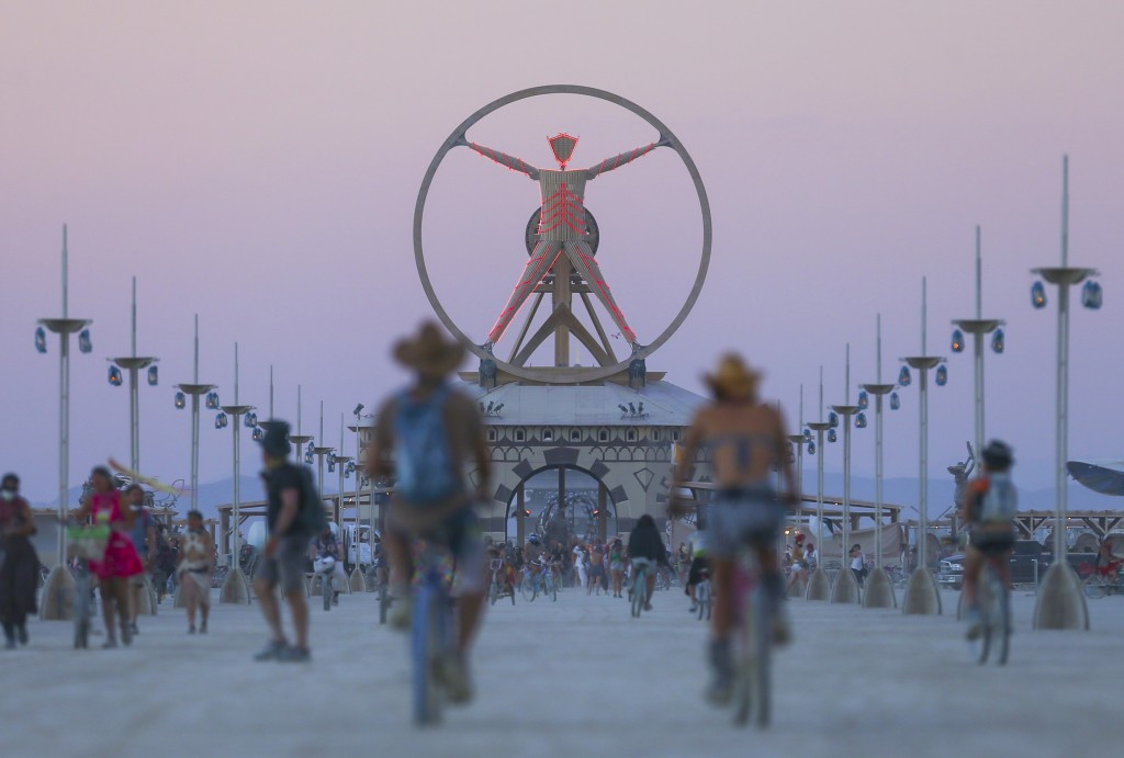 In this Wednesday, Aug. 31, 2016 photo, the Burning Man effigy, modeled after the Leonardo da Vinci's Vitruvian Man, stands above the playa during Burning Man at the Black Rock Desert north of Reno, Nev. (Chase Stevens/Las Vegas Review-Journal via AP)